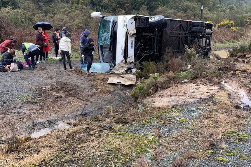 The bus carrying 27 people flipped to the opposite side of the road on State Highway 5 near Rotorua, a popular destination for tourist groups from China. PHOTO: REUTERS