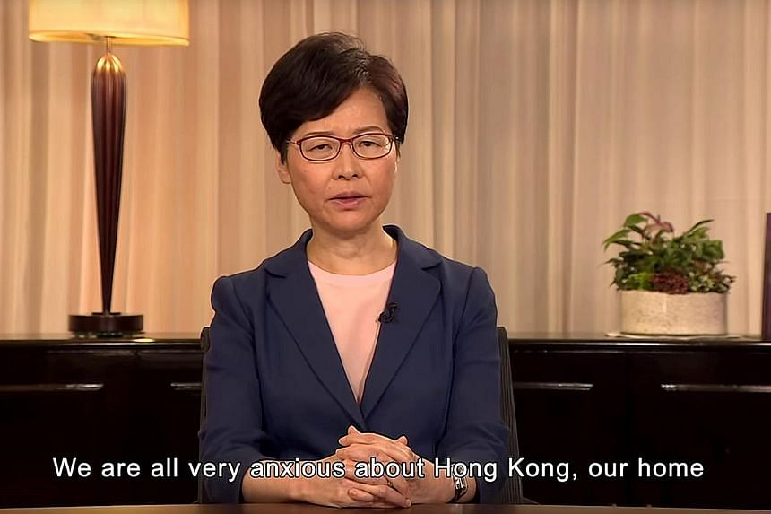 A screenshot from the televised video recording of Hong Kong Chief Executive Carrie Lam announcing that the government will move a motion to fully scrap the extradition Bill. She also said her administration will pave the way for dialogue, and called