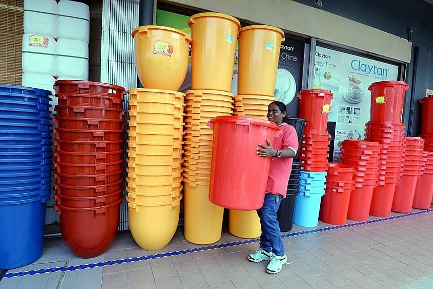 A Johor resident getting ready for the month-long water rationing exercise that will last until Oct 2. Nearly 150,000 residents across three areas in the Malaysian state have been subjected to water rationing since Monday, as a spell of hot weather w
