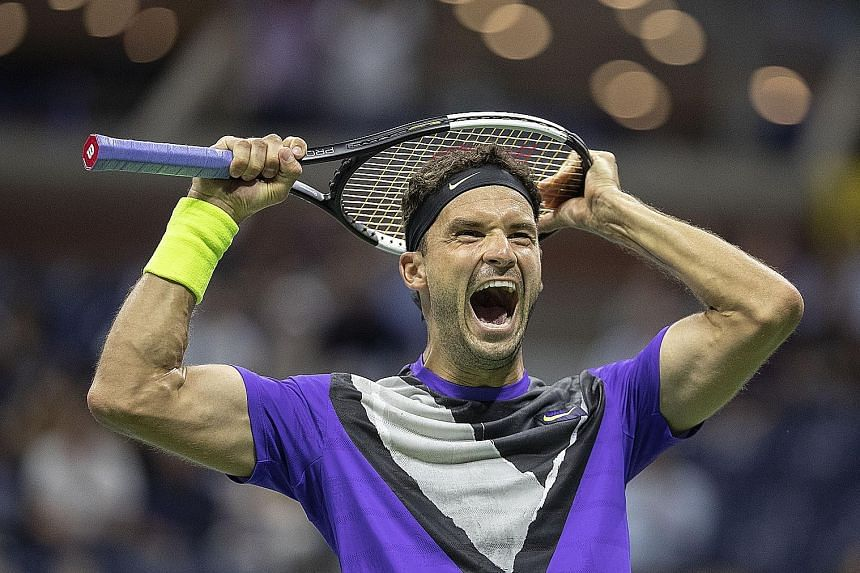 Bulgarian Grigor Dimitrov, a former top-10 player who has plunged to No. 78, is over the moon after defeating 20-time Grand Slam winner Roger Federer in their US Open quarter-final in New York on Tuesday. PHOTO: DPA A downcast Federer walks off the c