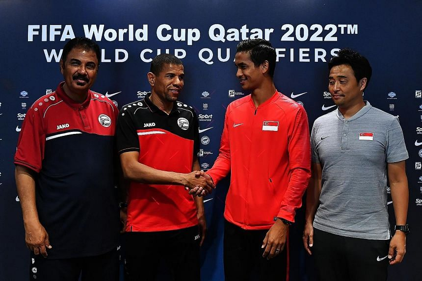 From left: Yemen coach Sami Hasan Al Hadi and his captain Salem Awad exchanging pleasantries with Singapore's vice-captain Safuwan Baharudin and coach Tatsuma Yoshida at the Oasia Hotel Novena. The teams play their opening 2022 World Cup qualifying m