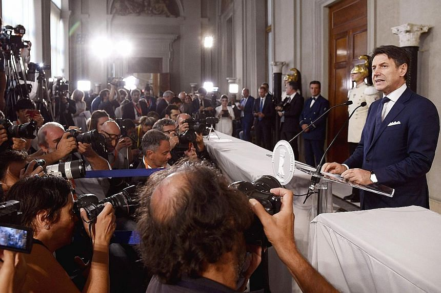 Italy's Prime Minister Giuseppe Conte reading out the list of ministers who will form his new Cabinet, drawn primarily from the 5-Star Movement and Democratic Party, after a meeting with Italian President Sergio Mattarella at the Quirinale Presidenti