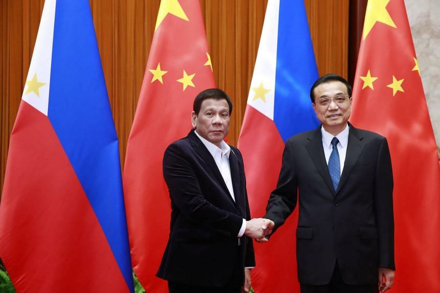 Philippine President Rodrigo Duterte (left) and Chinese Premier Li Keqiang shake hands during their meeting at the Great Hall of the People in Beijing, China, on Aug 30, 2019.