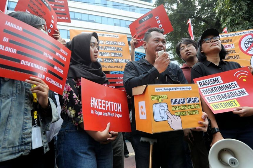 Indonesian activists hold protests posters during a rally in Jakarta, Indonesia, on Aug 23, 2019.