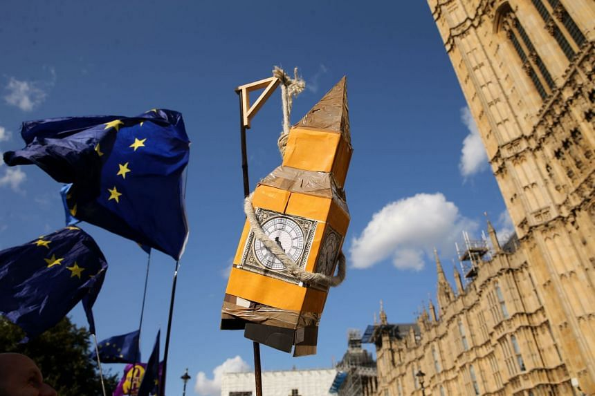 Activists display a model of Big Ben and EU flags outside the Houses of Parliament in central London.