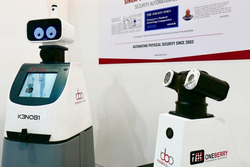 Oneberry Technologies' KenOB1 and RoboGuard robots on display at the Hannover Messe trade show on March 31, 2019.
