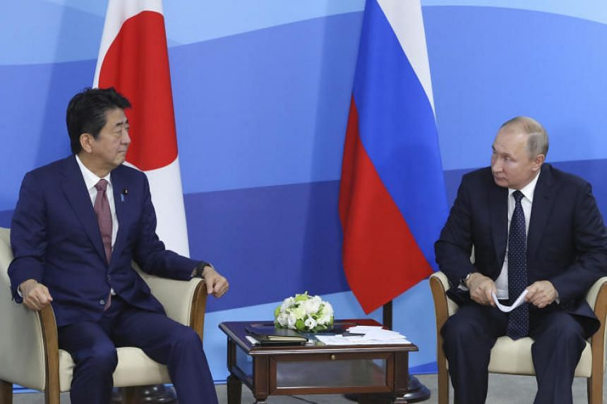 Japanese Prime Minister Shinzo Abe called on Russian President Vladimir Putin to resolve a row between the countries over a disputed chain of islands that has prevented the two countries signing a peace treaty.