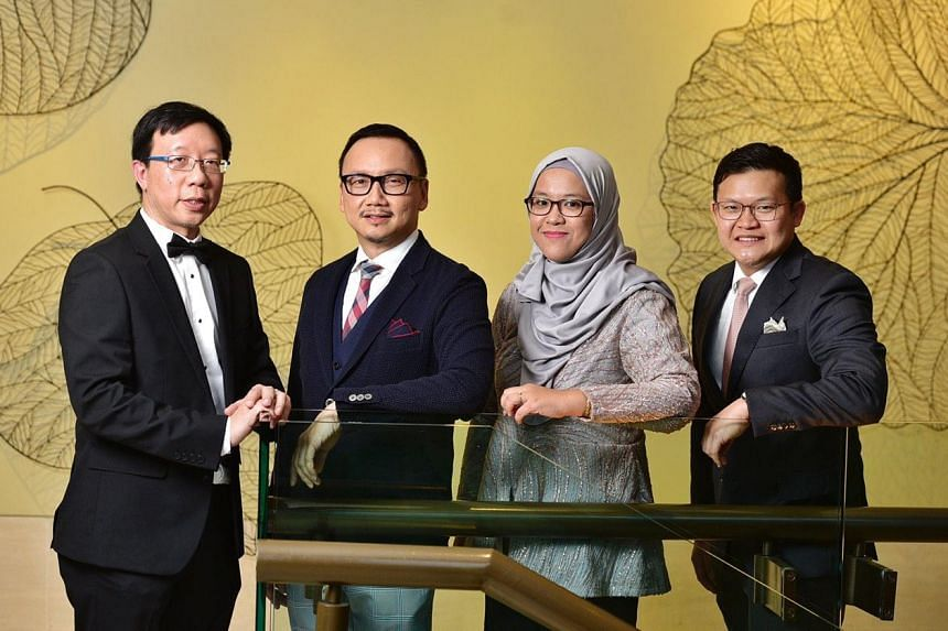 (From left) National Outstanding Clinician Educator Award recipient, Associate Professor Tan Boon Yeow, with medical director of the National Healthcare Group Eye Institute, Clinical Associate Professor Wong Hon Tym; senior manager of the Singapore N