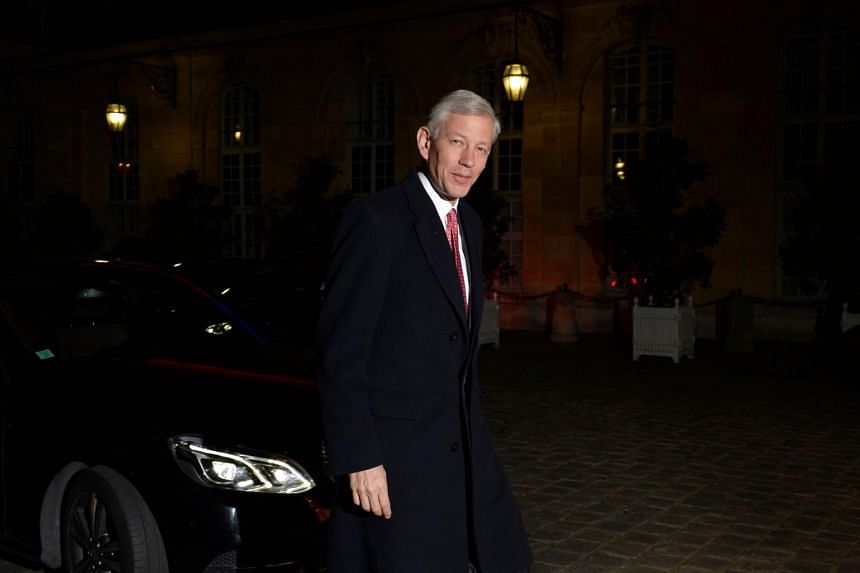 In this photo taken on Feb 16, 2014, Dominic Barton arrives for a dinner with the French Prime Minister and international business leaders in Paris. He is head of the Trudeau government's economic advisory council.