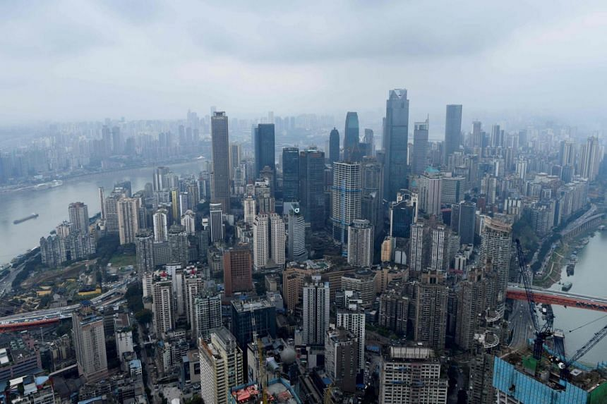 This picture taken on March 22, 2019 shows a skyline of Chongqing from the top of Raffles City Chongqing under construction in south-west China's Chongqing Municipality.