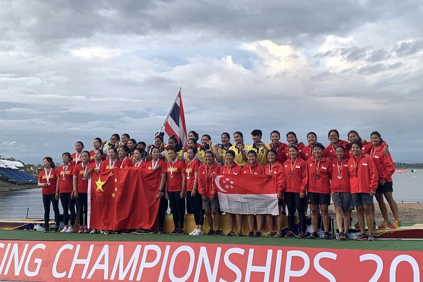 Singapore's women's dragon boat rowers (right) won their first-ever medal at the World Championships in Pattaya, Thailand.