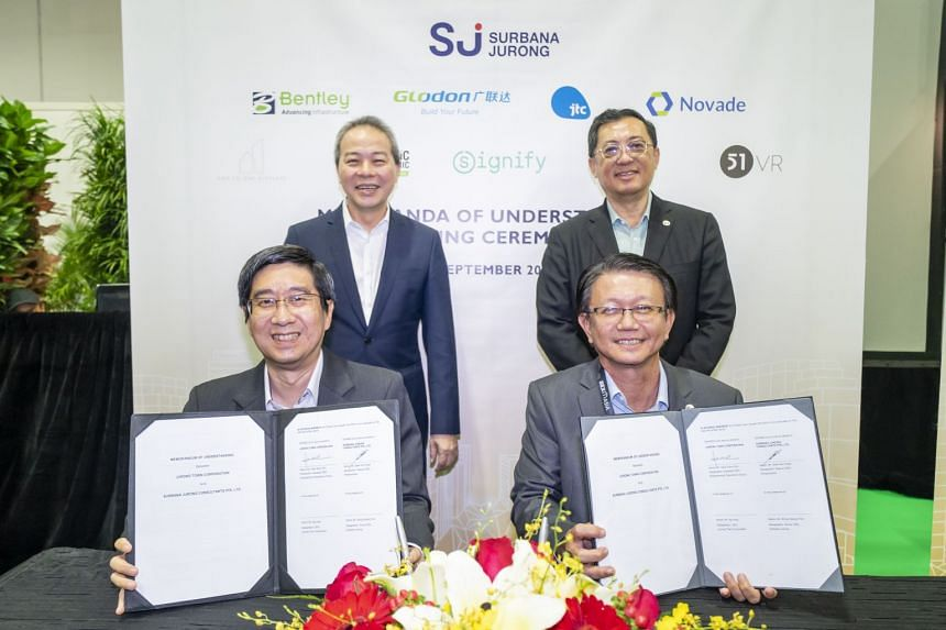 (Clockwise from back left) JTC chief executive Ng Lang, Surbana Jurong group CEO Wong Heang Fine, Surbana Jurong deputy CEO for infrastructure Seah Kim Huah and JTC assistant CEO for engineering and operations Heah Soon Poh at the signing of the memo