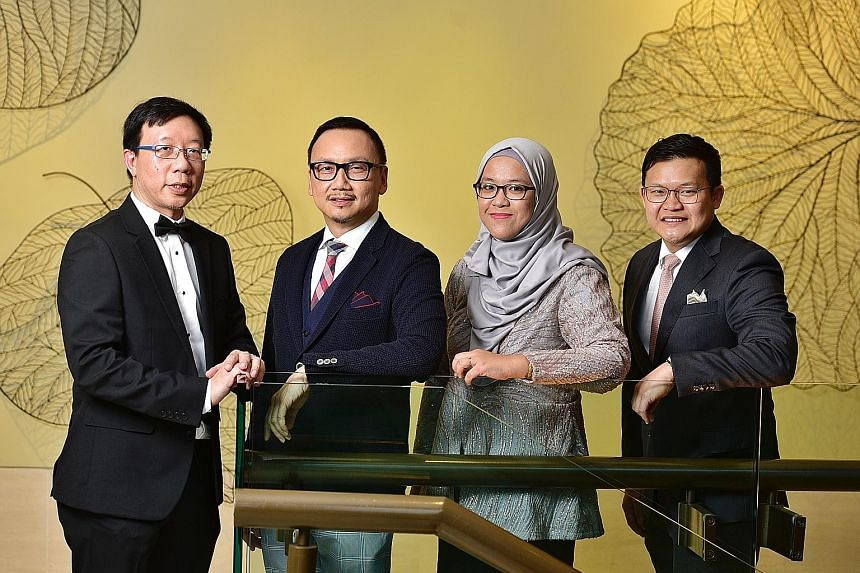 (From left) St Luke's Hospital CEO Tan Boon Yeow, who won the National Outstanding Clinician Educator Award; National Healthcare Group Eye Institute medical director Wong Hon Tym; senior manager Haslina Hamzah of the Singapore National Eye Centre (SN