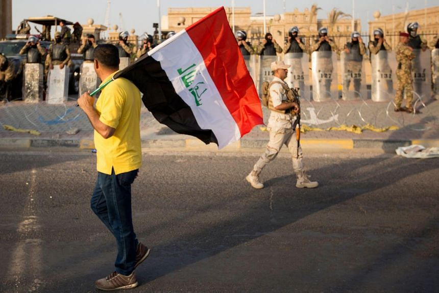 In divided Iraq, 'electronic armies' threaten activists
