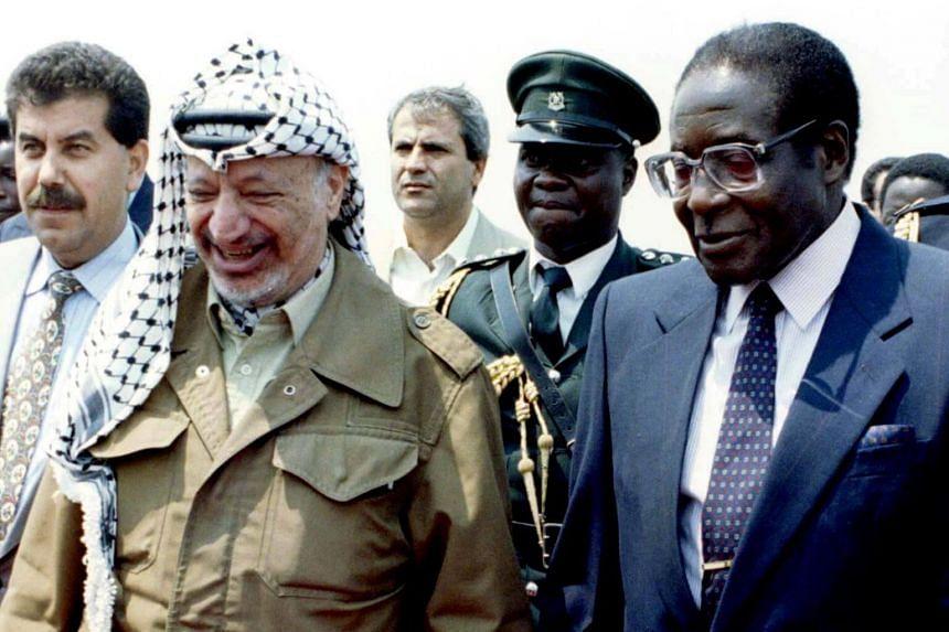 Robert Mugabe (right) meeting his Palestinian counterpart Yasser Arafat at the World Solar Summit in Zimbabwe, on Sept 15, 1996.