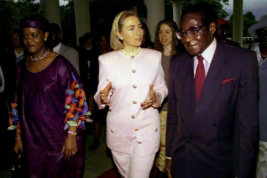 Robert Mugabe speaking to then US First Lady Hillary Clinton during her visit to Harare, Zimbabwe, on March 21, 1997.