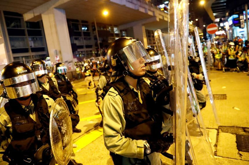 Riot police hold their shields outside Mong Kok police station, next to Prince Edward MTR station in Hong Kong, on Sept 6, 2019.