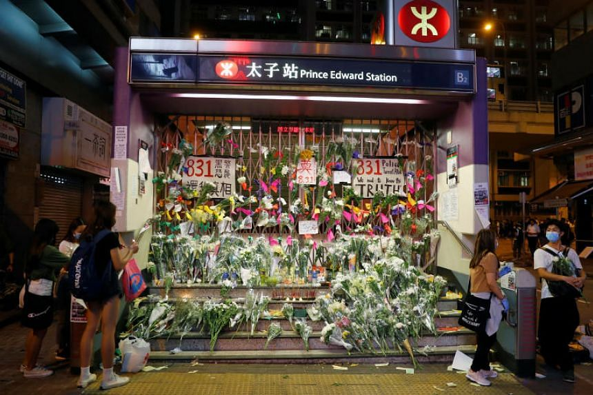 People lay down flowers outside Prince Edward MTR station in Hong Kong, on Sept 6, 2019.