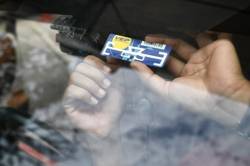 A Vehicle Entry Permit (VEP) radio frequency identification (RFID) tag being attached on a vehicle's windscreen.
