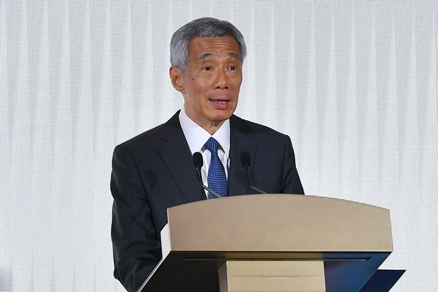 In a photo taken on Aug 26, Prime Minister Lee Hsien Loong delivers a speech at a gala dinner marking the 70th anniversary of Singapore's Inter-Religious Organisation. PM Lee is suing the editor of The Online Citizen (TOC), Mr Terry Xu, over an artic