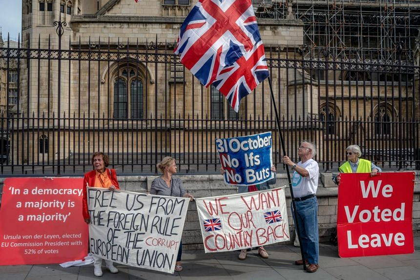 Pro-Brexit demonstrators outside the Houses of Parliament in London, Britain, on Sept 5, 2019.