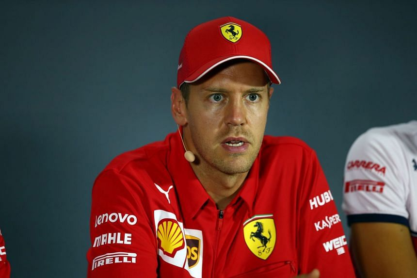Vettel attends a press conference at the Monza circuit.