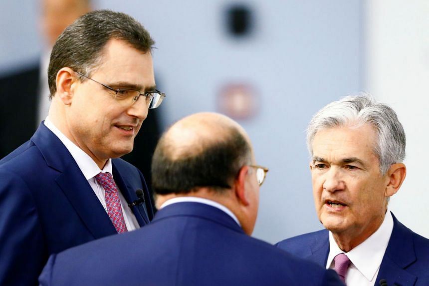 US Federal Reserve Chairman Jerome Powell (left) and Swiss National Bank chairman Thomas Jordan arrive for the The Economic Outlook And Monetary Policy panel discussion hosted by the Swiss Institute of International Studies at the University of Zuric
