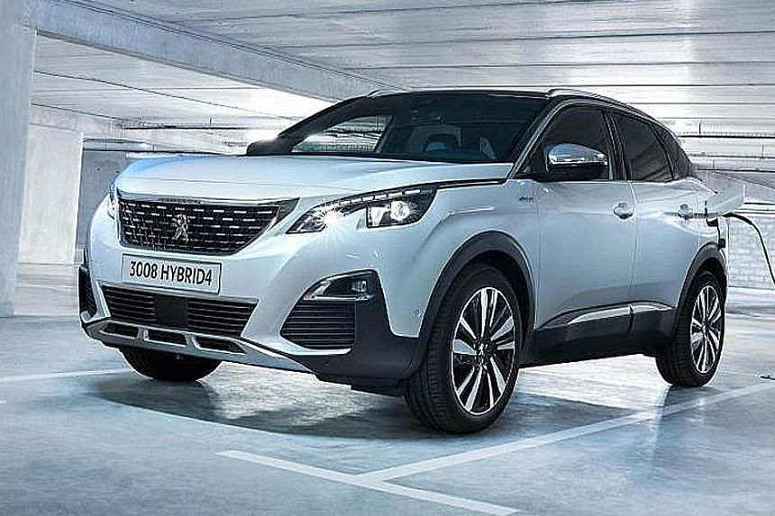 The Peugeot 3008 GT Hybrid4 (above) is powered by a 1.6-litre turbo petrol engine and two electric motors, making a combined 300hp.