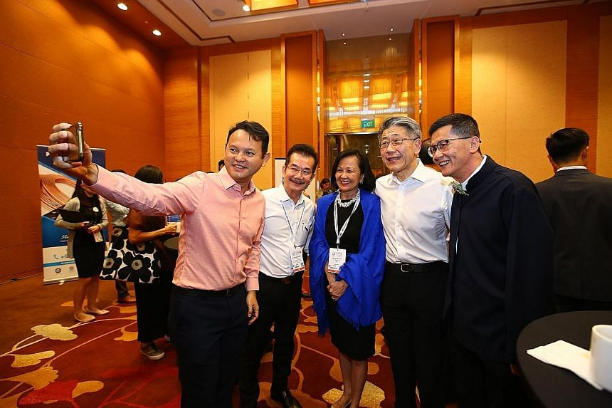 Minister of State for National Development and Manpower Zaqy Mohamad taking a wefie with (from left) City Developments group general manager Chia Ngiang Hong, CBRE chairman of South-east Asia Pauline Goh, Far East Organization CEO Philip Ng and A.I.M