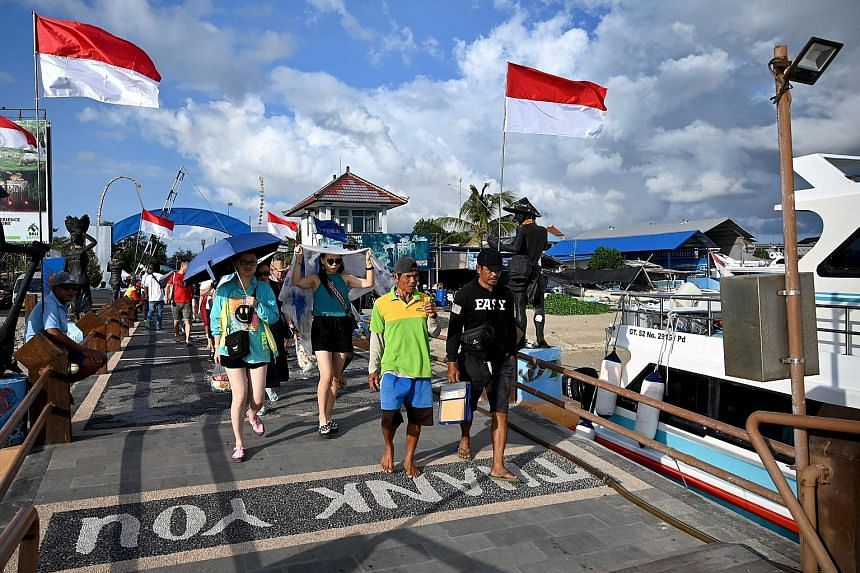 Chinese tourists on their way to catch a boat in Bali last month. The tourism boom dissipated this year as China's economy slowed, the yuan weakened and the US-China trade war hit consumer confidence. PHOTO: AGENCE FRANCE-PRESSE