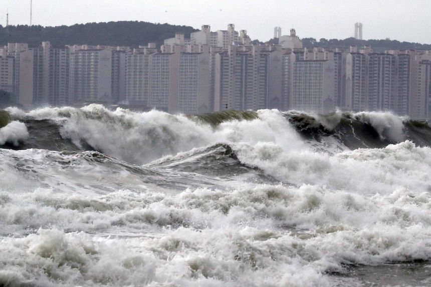 High waves batter a beach in the southern port city of Busan on Sept 7, 2019, as Typhoon Lingling brushes up against the Korean Peninsula.