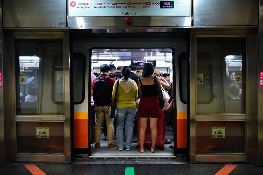 Passengers on an MRT train at Braddell station on July 17, 2018.