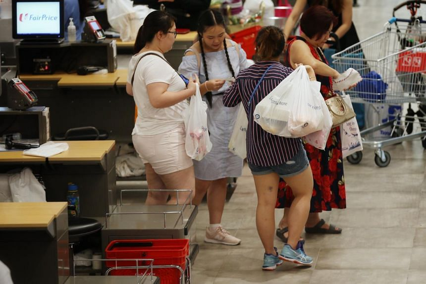 Shoppers using plastic bags at NTUC FairPrice Xtra at Vivocity on Sept 4, 2019.