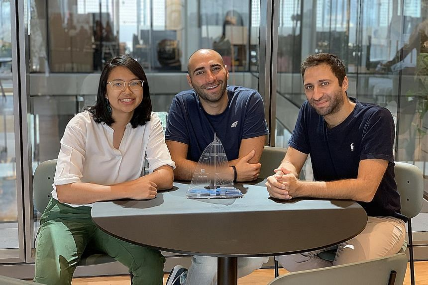 Singapore University of Technology and Design third-year student Eunice Lee with Tel Aviv start-up Pick a Pier co-founders and brothers Idan Cohen (centre) and Asaf Cohen.