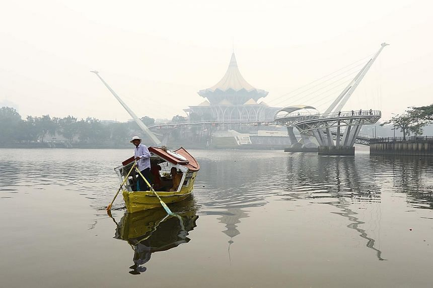 The State Legislative Assembly complex in Kuching shrouded in haze yesterday morning. The Sarawak capital registered an Air Pollutant Index reading of 216, in the very unhealthy range, at 2pm yesterday.