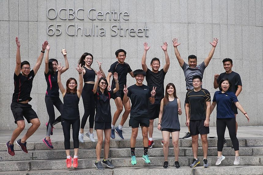 Lion Global Investors' chief marketing officer Lim Shyong Piau (back row, third from right) believes in the importance of living a healthy lifestyle. He will be flagging off the ST Run's 3.5km category on Sept 29. The company, a subsidiary of Great E