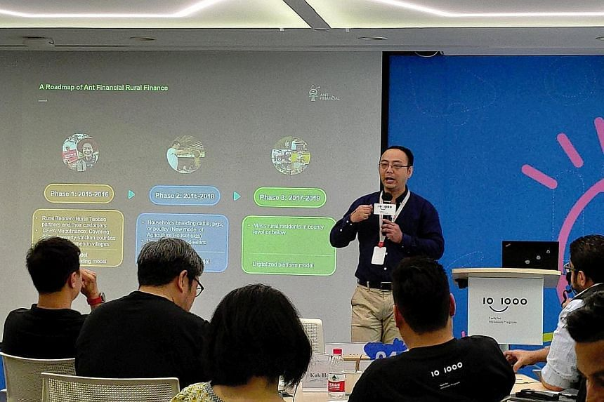 Participants at Ant Financial's Tech Innovator Workshop in Hangzhou two weeks ago. Ant Financial is the fintech affiliate of Alibaba. Ms Utari Octavianty at Freshippo, Alibaba's robot-driven supermarket, in Hangzhou, on Aug 28, under the Tech for Inc