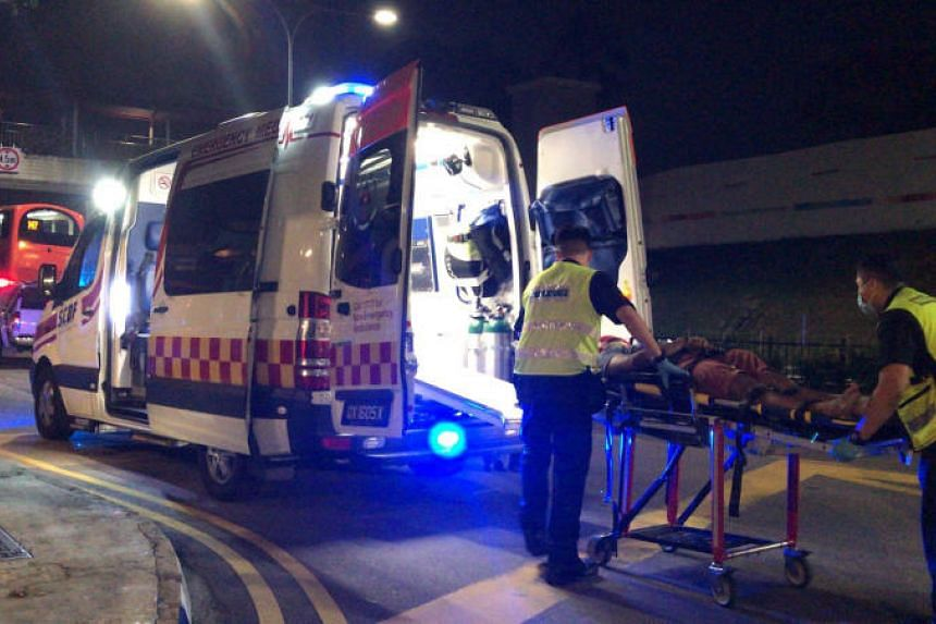 One of the injured was carried onto an ambulance after a car crashed into a bus stop along Kampong Bahru Road on Sept 7, 2019.