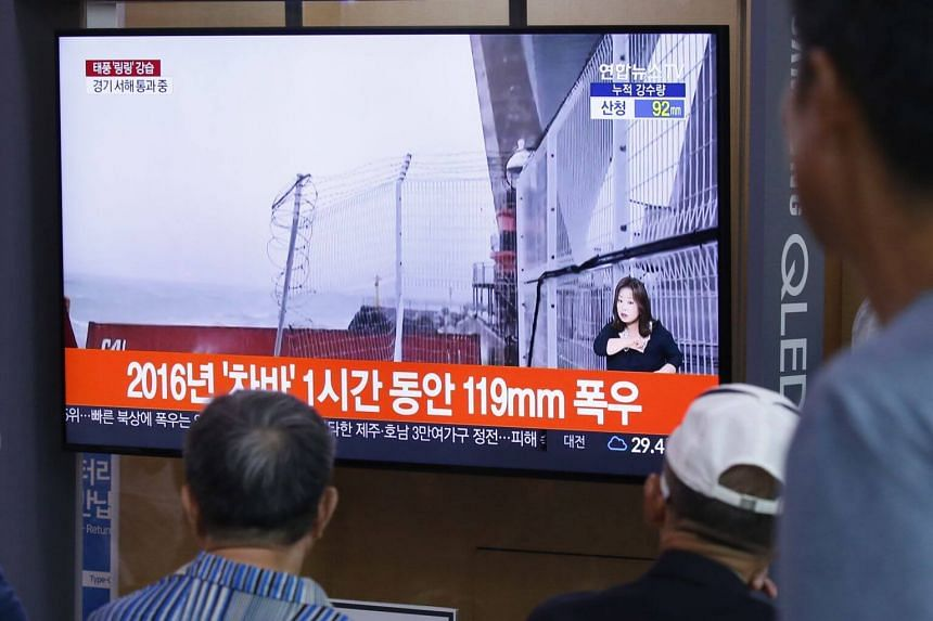 People watching a news report about Typhoon Lingling at the Seoul Station, in South Korea, on Sept 7, 2019.