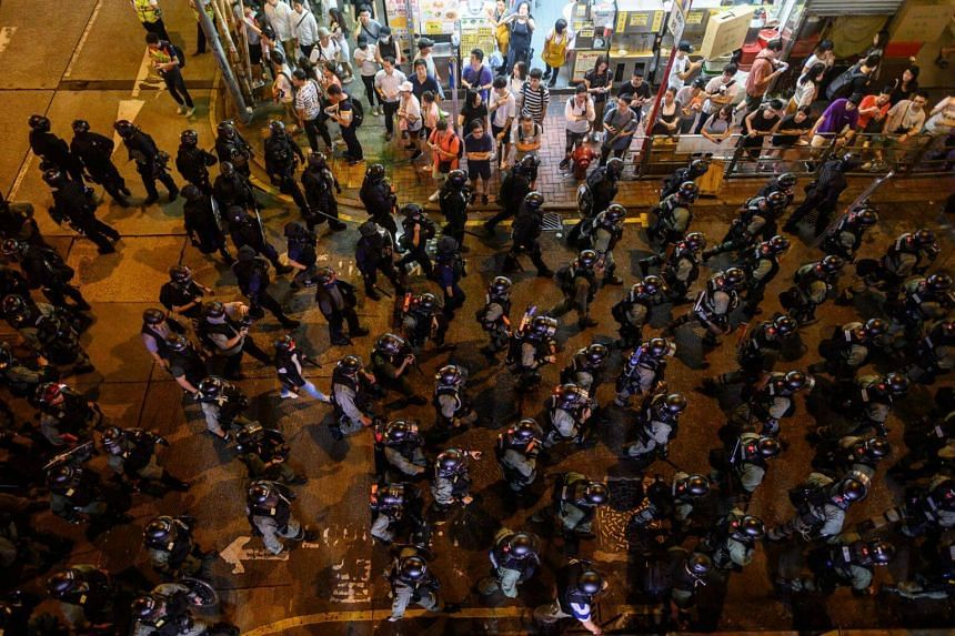 Riot police patrolling on a street during a protest in Mong Kok on Sept 7, 2019.