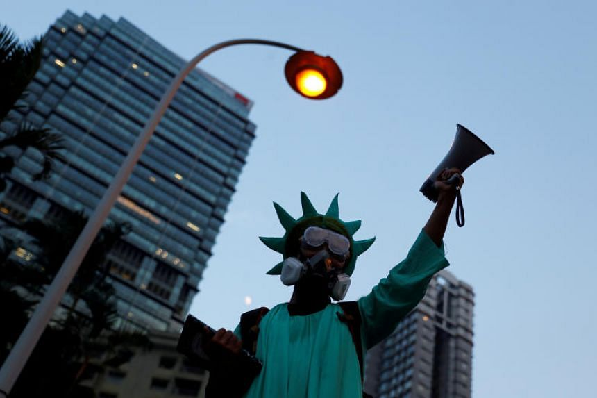 A protester dressed as the Statue of Liberty in Hong Kong's Central district on Sept 8, 2019.