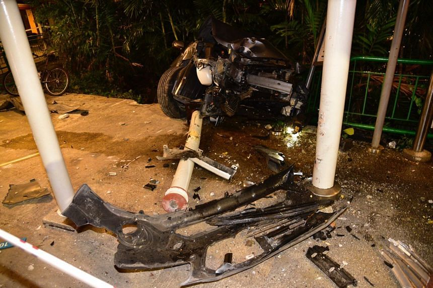 Parts of the car were strewn across the bus-stop after the crash along Kampong Bahru Road and one of the pillars was knocked down.