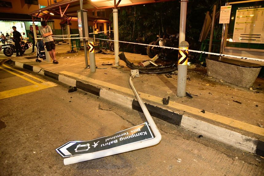 A signpost was knocked down after a car crashed into a bus stop along Kampong Bahru Road late on Sept 7, 2019.