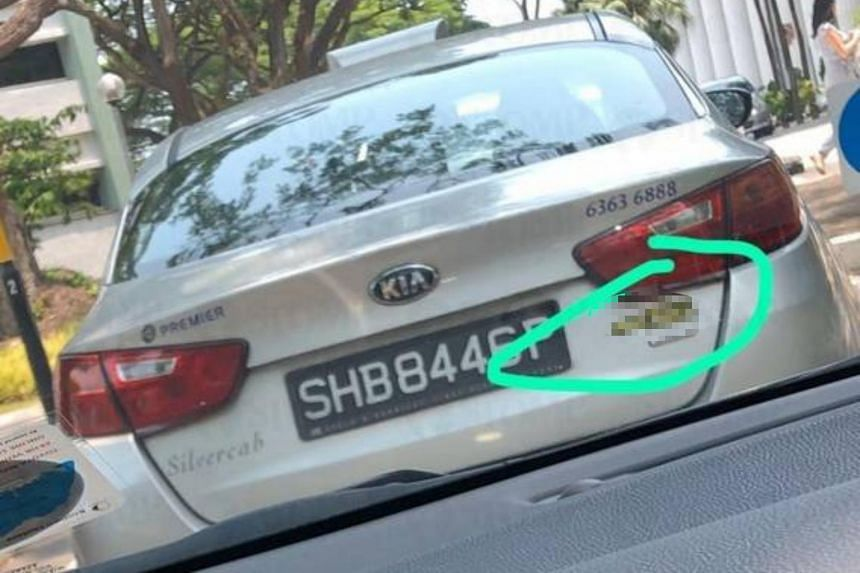 The sticker shows the name of a website that produces videos of drivers and passengers engaged in sexual acts in taxis.