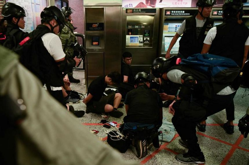 Protesters being detained at the Central MTR station in Hong Kong on Sept 8, 2019.