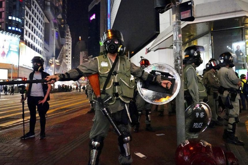 Riot police block a street in Hong Kong's Central district on Sept 8, 2019.