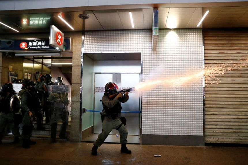 Riot police fire tear gas outside the Causeway Bay MTR station on Sept 8, 2019.