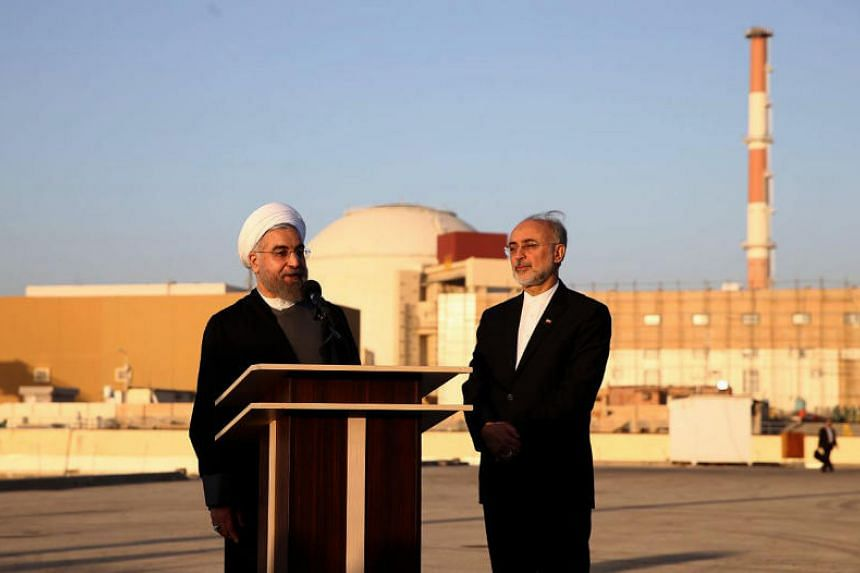 In a photo released on Jan 13, 2015, Iranian President Hassan Rouhani and Iran's Atomic Energy Organisation chief Ali Akbar Salehi address journalists at the Bushehr nuclear power plant in the Gulf port city of Bushehr.