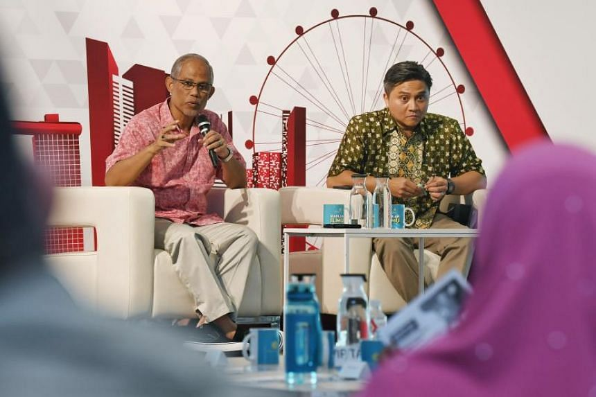 Muslim Affairs Masagos Zulkifli (left) and Bishan-Toa Payoh GRC MP Saktiandi Supaat during a dialogue at the Devan Nair Institute for Employment and Employability on Sept 8, 2019.