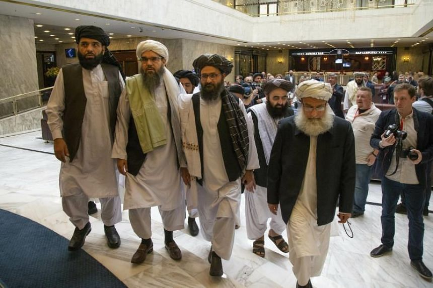 In a photo taken on May 28, Mullah Abdul Ghani Baradar (third from left), the Taleban group's top political leader, arrives with other members of the Taleban delegation for talks in Moscow.